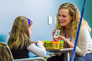speech therapist and child during rehabilitation