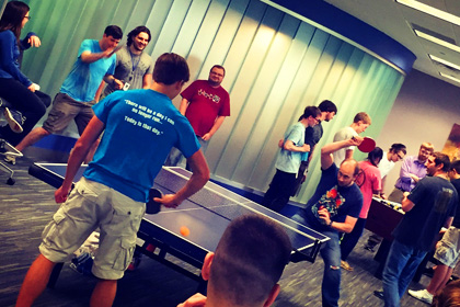 Interns playing ping pong