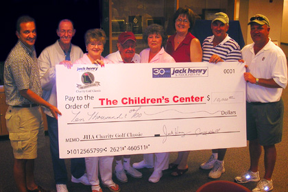 Group of employees with check for The Children's Center