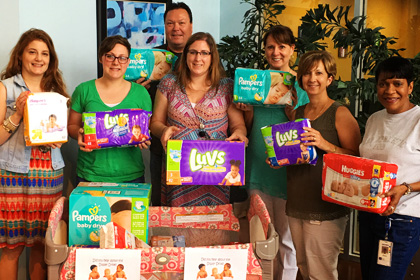 Group of employees with gifts for charity
