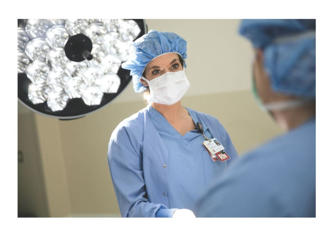 Two OR nurses preparing the operating room for surgery