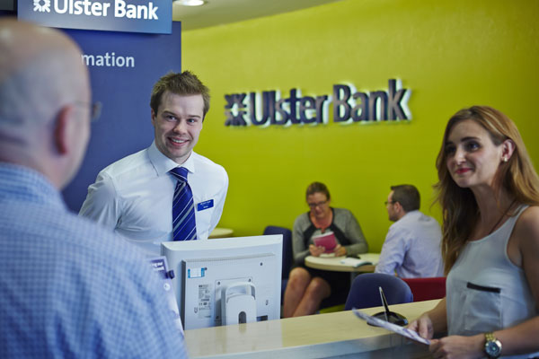 Employees greeting customer at Ulster Bank reception desk