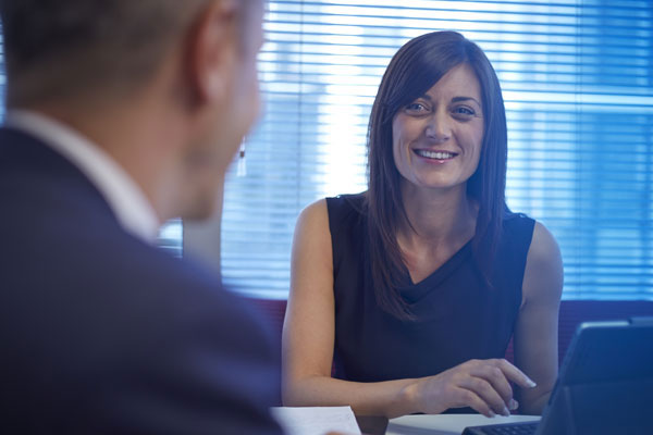 Female smiling in meeting