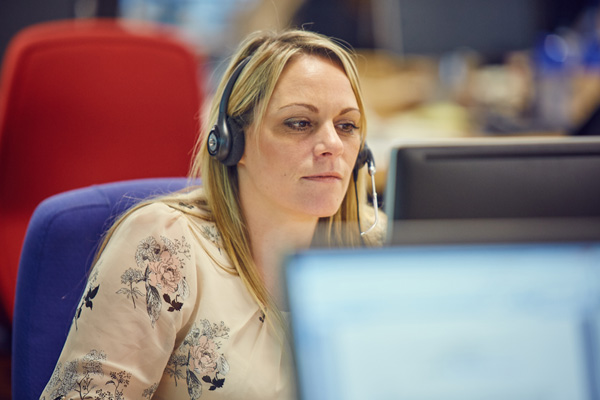 Woman at desk headset