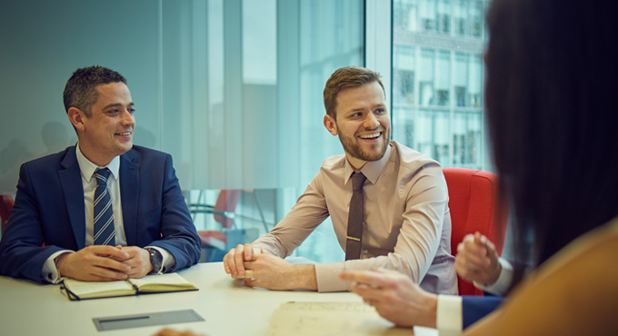 Man smiling in meeting